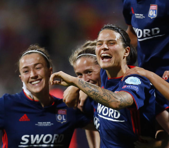 FILE - In this May 24, 2018, file photo, Lyon's Dzsenifer Marozsan, right, celebrates with teammates after Lyon scored against Wolfsburg, in Kiev, Ukraine. Marozsan will be playing for Germany in the Women's World Cup, that kicks off Friday, June 7, 2019, in Paris. (AP Photo/Efrem Lukatsky, File)