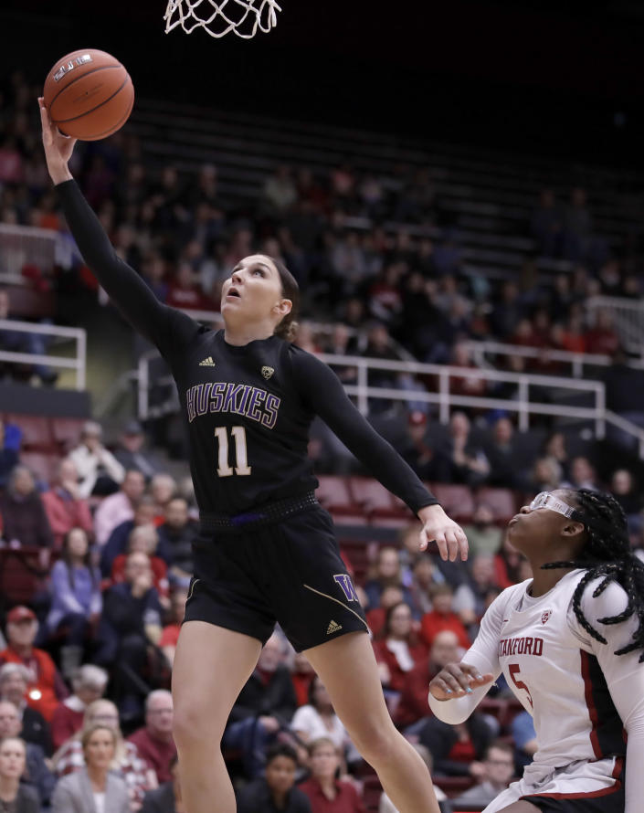 Washington's Haley Van Dyke, left, lays up a shot over Stanford's Francesca Belibi (5) during the first half of an NCAA college basketball game Sunday, Jan. 5, 2020, in Stanford, Calif. (AP Photo/Ben Margot)