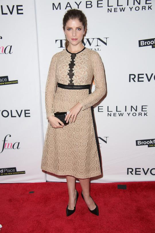 <p>The Pitch Perfect 2 star presented the award for Fashion Magazine of the Year to Elle Magazine's editor in chief Robbie Myers. The actress wore a nude, tea-length lace dress with black details, paired with black pumps and a small box clutch—a mature look for the 30 year old star. <br /></p><p><br /></p>