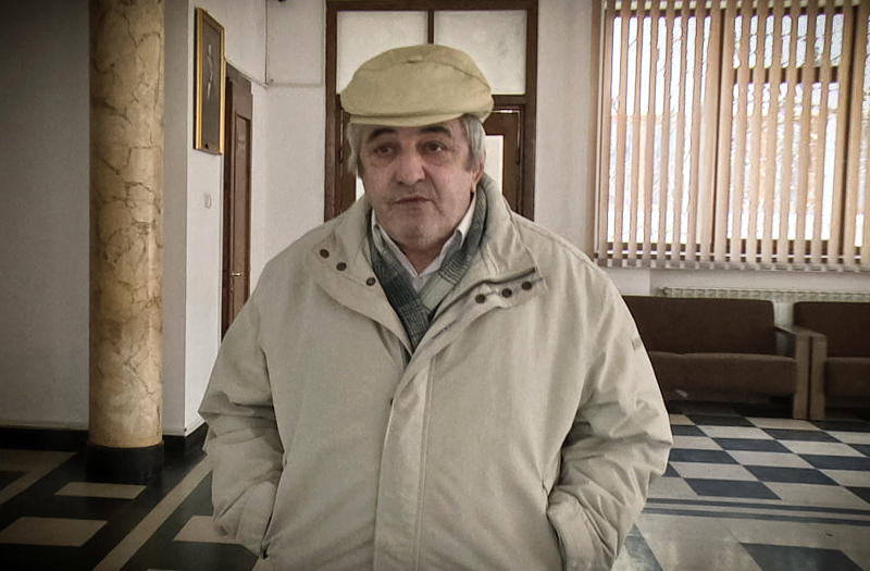 "In this Wednesday, March 14, 2018 photograph Constantin Reliu speaks to media, outside a courtroom, in Vaslui, northern Romania. A Romanian court has rejected a man's claim that he's alive, after he was officially registered as deceased, according to a court spokeswoman who said that the 63-year-old man has lost his case because he appealed too late. I am a living ghost,"" he said venting his frustration against local authorities and his wife who he says unlawfully took ownership of a property after he was declared dead.  (Simona Voicu/Adevarul via AP)"