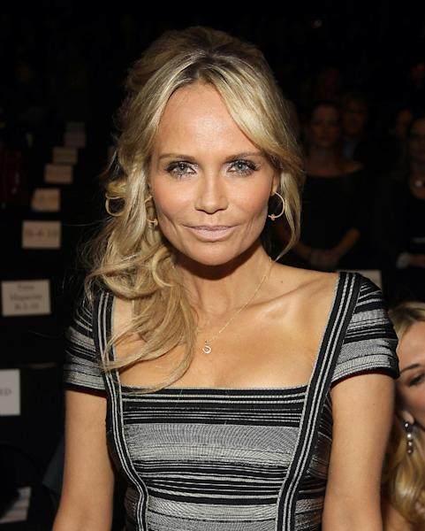 FILE - In this Feb. 11, 2012 file photo, actress Kristin Chenoweth attends the Herve Leger Fall 2012 show during Fashion Week in New York. American Country Awards announced Tuesday, Aug. 28, 2012 that country star Trace Adkins and entertainer Kristin Chenoweth are returning as hosts of the 3rd American Country Awards. (AP Photo/ Donald Traill, File)