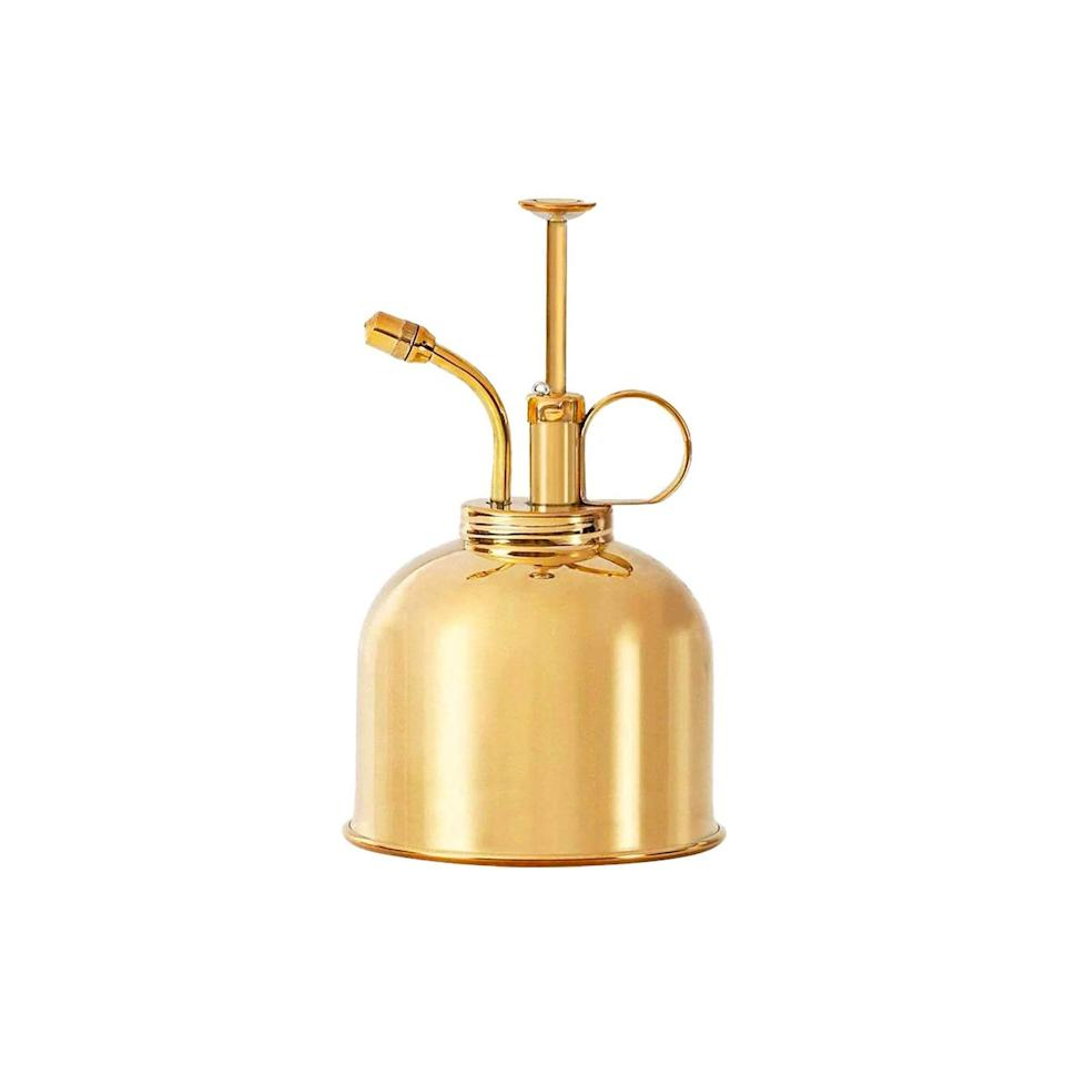 """This tiny brass plant mister could easily pass for a SoHo boutique find. $28, Amazon. <a href=""""https://www.amazon.com/dp/B01FCFECWY/ref=s9_acss_bw_pg_Pillow_3_i?"""" rel=""""nofollow noopener"""" target=""""_blank"""" data-ylk=""""slk:Get it now!"""" class=""""link rapid-noclick-resp"""">Get it now!</a>"""