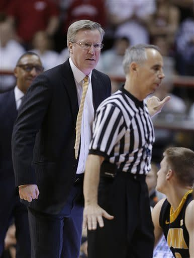 Iowa coach Fran McCaffery, left, continues to yell at an official after he was called for a technical foul in the first half of an NCAA college basketball game against Indiana in Bloomington, Ind., Saturday, March 2, 2013. (AP Photo/Michael Conroy)