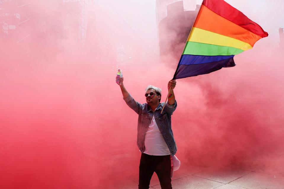 A participant flutters a rainbow flag at the Angel of Independence monument although the Mexican LGBT community called for an online gay pride celebration as a protective measure amid the coronavirus disease (COVID-19) outbreak, in Mexico City, Mexico June 27, 2020