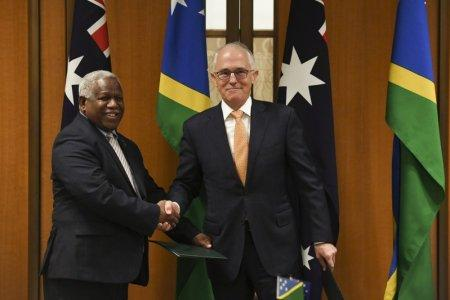 Prime Minister of the Solomon Islands Rick Houenipwela and Australian Prime Minister Malcolm Turnbull shake hands during a signing ceremony at Parliament House in Canberra, Australia, June 13, 2018. AAP/Lukas Coch/via REUTERS