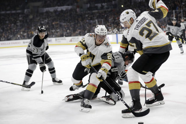Vegas Golden Knights' Cody Eakin (21) becomes entangled with Los Angeles Kings' Anze Kopitar (11) and teammate Shea Theodore (27) during the second period of an NHL hockey game Saturday, Dec. 29, 2018, in Los Angeles. (AP Photo/Marcio Jose Sanchez)