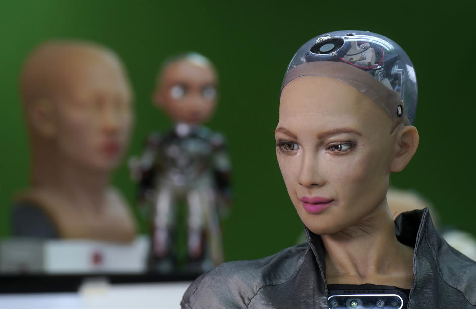 The close-up of the head of Sophia is seen at Hanson Robotics studio in Hong Kong on March 29, 2021. Sophia is a robot of many talents, she speaks, jokes, sings and even makes art. In March, she caused a stir in the art world when a digital work she created as part of a collaboration was sold at an auction for $688,888 in the form of a non-fungible token (NFT). (AP Photo/Vincent Yu)