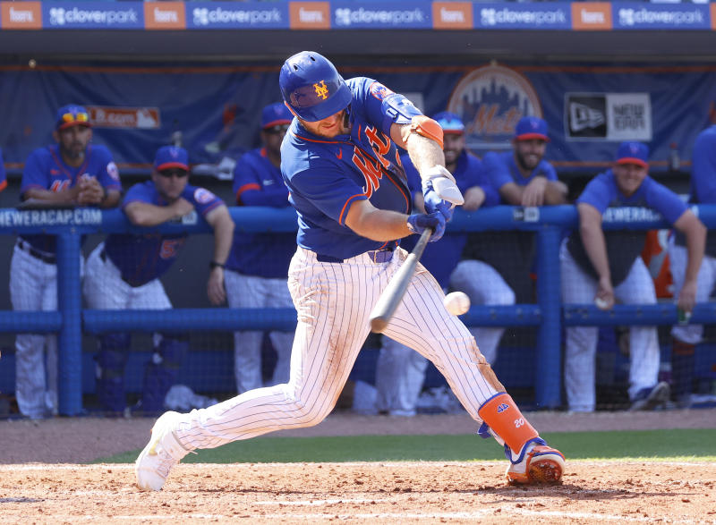Pete Alonso #20 of the New York Mets hits the ball against the St Louis Cardinals.