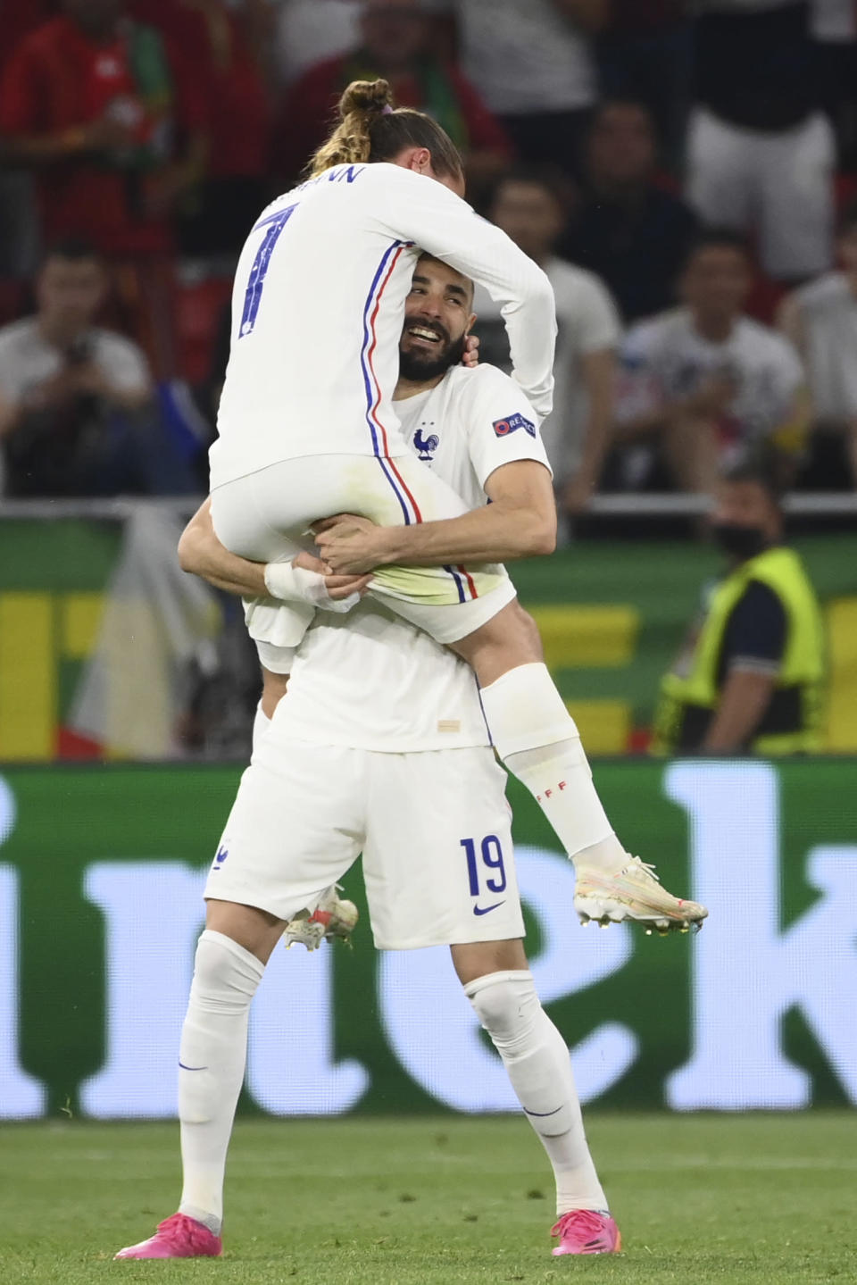 France's Karim Benzema celebrates with Antoine Griezmann, left,after scoring his side's second goal during the Euro 2020 soccer championship group F match between Portugal and France at the Puskas Arena in Budapest, Wednesday, June 23, 2021. (Franck Fife, Pool photo via AP)