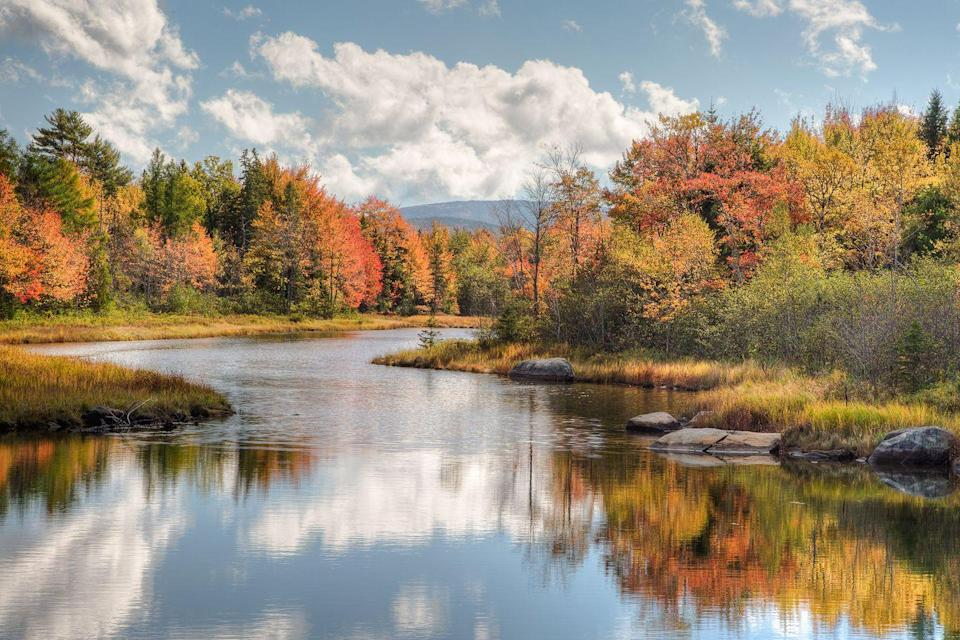 """<p>Who wouldn't want to take an autumn canoe ride on this gorgeous river in <a href=""""https://www.countryliving.com/life/travel/g3990/maine-tourist-ideas/"""" rel=""""nofollow noopener"""" target=""""_blank"""" data-ylk=""""slk:Maine"""" class=""""link rapid-noclick-resp"""">Maine</a>? </p>"""