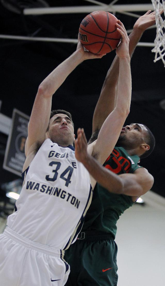 George Washington John Kopriva (34) goes up for a shot with Miami forward Donnavan Kirk, right, defending in the first half of an NCAA college basketball game at the Wooden Legacy tournament, Thursday, Nov. 28, 2013, in Fullerton, Calif. (AP Photo/Alex Gallardo)