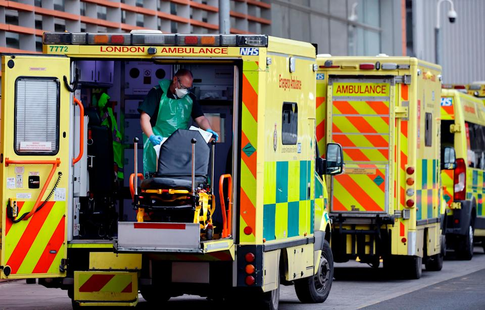<strong>A member of ambulance crew puts a stretcher back into and empty ambulance at the Royal Free Hospital in London.</strong> (Photo: TOLGA AKMEN via Getty Images)