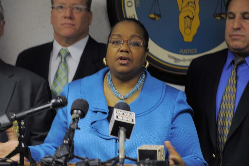 Wayne County Prosecutor Kym Worthy, surrounded by prosecutors and law enforcement officers, speaks during a press conference Wednesday, April 17, 2013 at the Frank Murphy Hall of Justice in Detroit. Robert Bashara, a man accused of forcing a handyman to strangle his wife was charged with first-degree murder Wednesday, 15 months after the discovery of her body in a Detroit alley stirred fear that she was a victim of a random abduction from a comfortable suburb. (AP Photo/Detroit News, Steve Perez) DETROIT FREE PRESS OUT; HUFFINGTON POST OUT