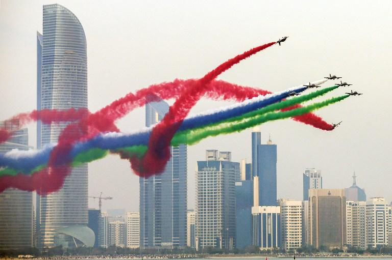 """<p>Planes performing in an airshow as part of the """"Union Fortress Live Military Demonstration"""", above the Abu Dhabi Corniche. </p>"""