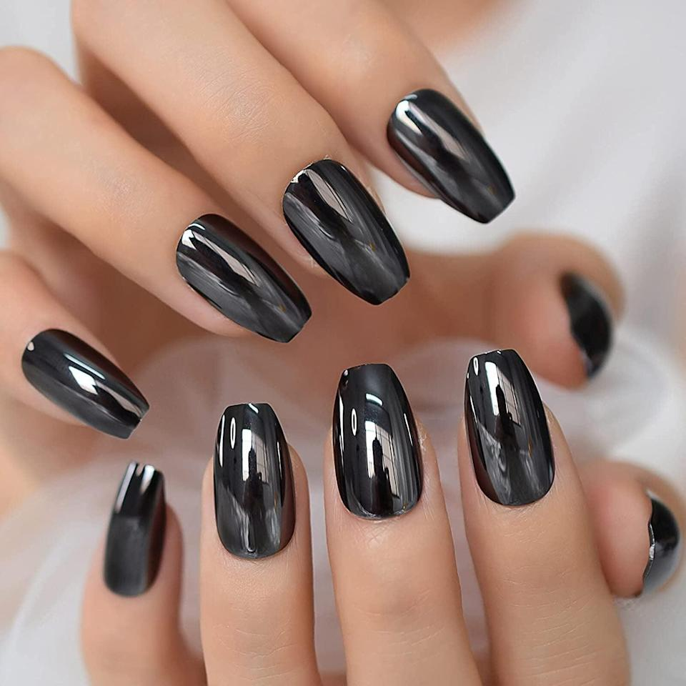 <p>Live in the year 3000 with these futuristic chromatic <span>Coolnail Metallic Mirror Effect Gray Black Press-On Nails</span> ($6). It's such a statement-making set that will garner compliments galore!</p>