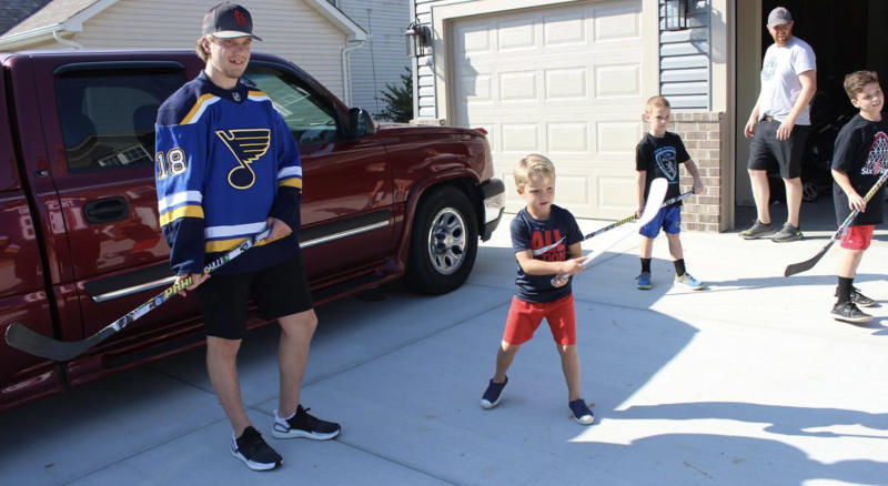 Robert Thomas puts his skills to the test against members of the Hanlon family. (stlouisblues.com)