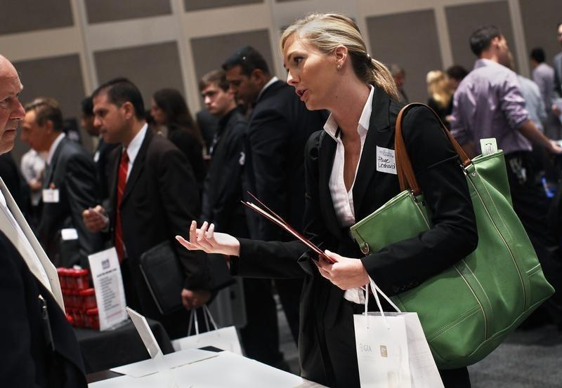 Paige Leonard speaks with a recruiter from a jewelry and gem company during the GIA Jewelry Career Fair in New York