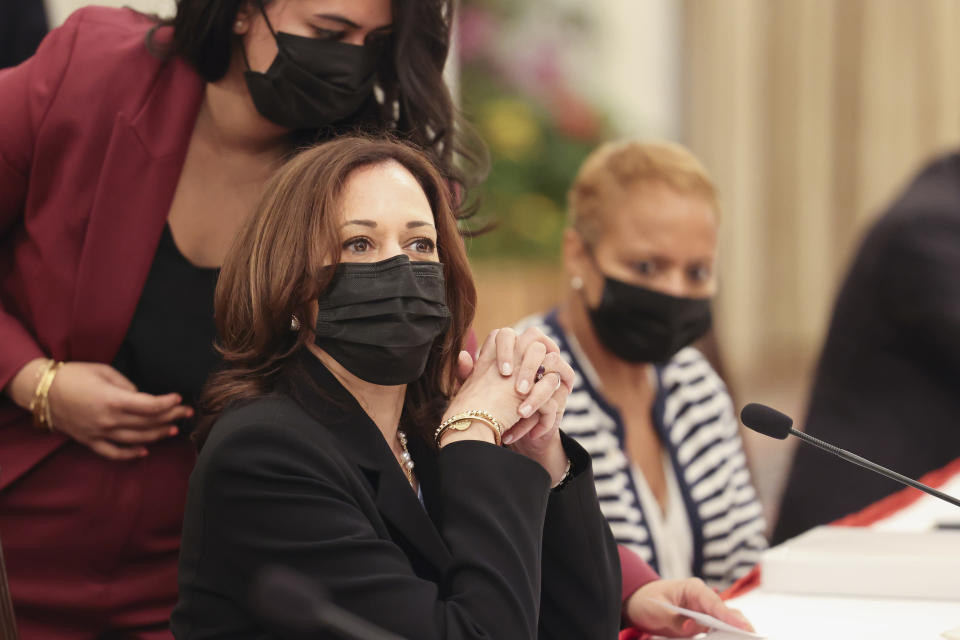 U.S. Vice President Kamala Harris, front left, attends a bilateral meeting with Singapore's Prime Minister Lee Hsien Loong at the Istana in Singapore Monday, Aug. 23, 2021. (Evelyn Hockstein/Pool Photo via AP)
