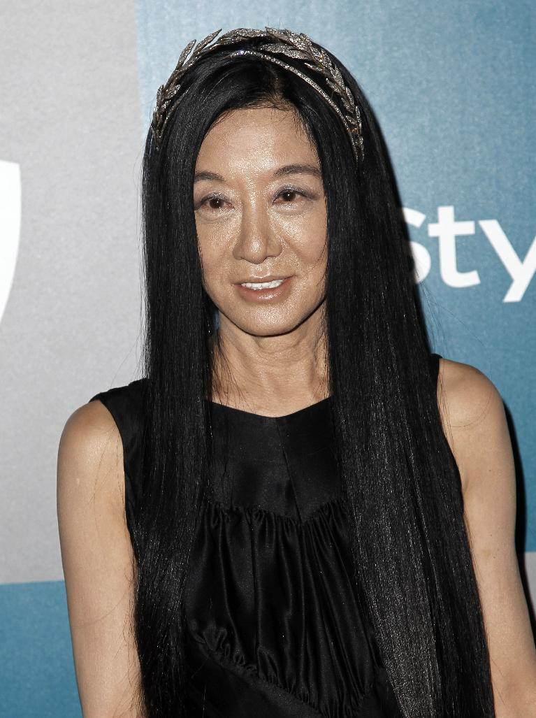 "FILE - This Jan. 15, 2012 file photo shows fashion designer Vera Wang at the 2012 Warner Bros. and InStyle Golden Globe After Party at the Beverly Hilton in Los Angeles. Wang, who launched her label with wedding gowns, is separating from her husband Arthur Becker. A statement was issued to Women's Wear Daily earlier this week from company president Mario Grauso that said Wang and Becker ""mutually and amicably agreed to separate."" The couple married in 1989, when she still worked for Ralph Lauren. They have two daughters. (AP Photo/Matt Sayles, file)"