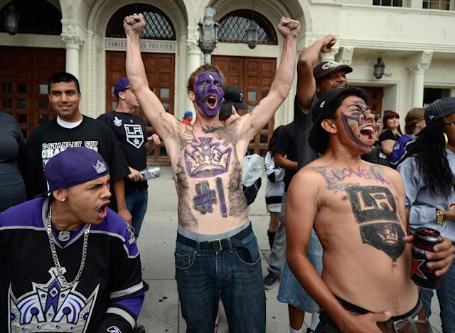 LOS ANGELES, CA - JUNE 14: Corey Brankin (C) and Johnny Castellanos (R) from Lancaster, California, cheer before the start of the Los Angeles Kings Stanley Cup victory parade on June 14, 2012 in Los Angeles, California. The Kings are celebrating thier first NHL Championship in the team's 45-year-old franchise history. (Photo by Kevork Djansezian/Getty Images)
