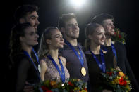 Victoria Sinitsina and Nikita Katsalapov of Russia, center, Alexandra Stepanova and Ivan Buki of Russia, right, and Gabriella Papadakis and Guillaume Cizeron of France pose with their medals after the ice dance free dance competition at the ISU European figure skating championships in Graz, Austria, Saturday, Jan. 25, 2020. (AP Photo/Matthias Schrader)