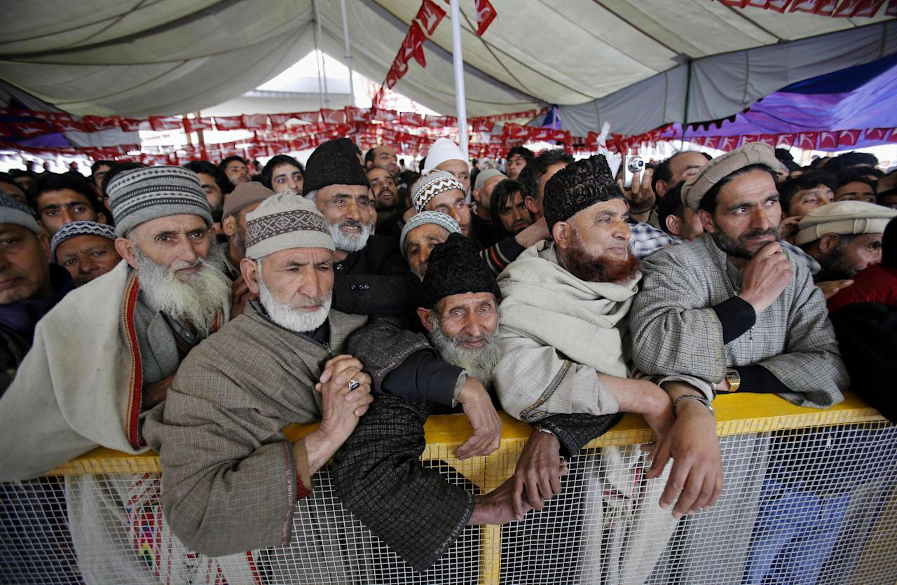 National Conference party supporters attend an election rally on the outskirts of Srinagar, India, Monday, April 7, 2014. India started the world's largest election Monday where the country's 814 million electorate will vote in stages over the next five weeks. (AP Photo/Mukhtar Khan)