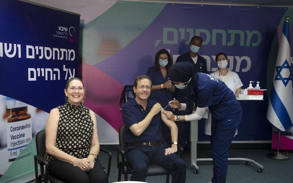 Israeli president Isaac Herzog receives a third dose of the Pfizer Covid-19 vaccine, along with his wife Michal, at Sheba Medical Centre in Ramat Gan, Israel on 30 July 2021 - Maya Alleruzzo/Shutterstock