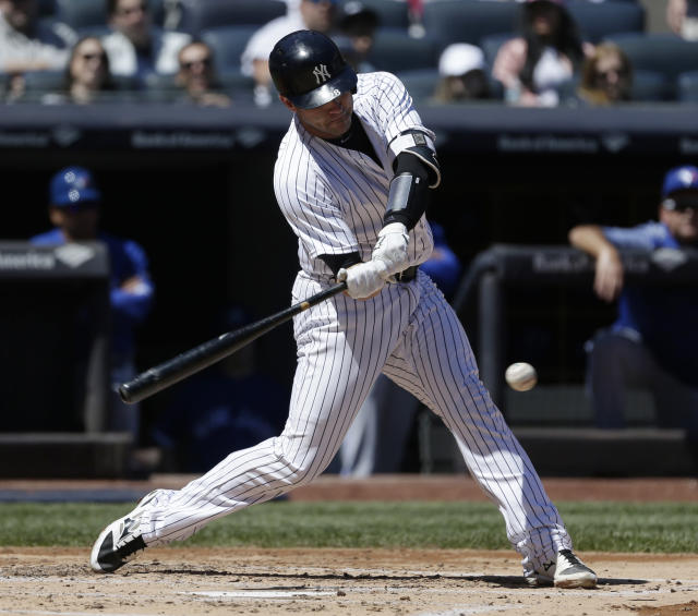 New York Yankees' Austin Romine hits a two-run double during the second inning of the baseball game against the Toronto Blue Jays at Yankee Stadium Sunday, April 22, 2018 in New York. (AP Photo/Seth Wenig)