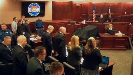 James Holmes (2nd L) stands at the start of his trial in Arapahoe County District Court in Centennial, Colorado in this still image captured from a pool video footage April 27, 2015.   REUTERS/Reuters TV/Pool