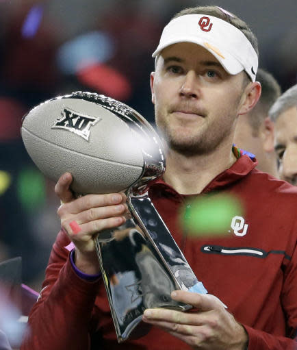 FILE - In this Dec. 2, 2017, file photo, Oklahoma head coach Lincoln Riley holds the Big 12 Conference championship NCAA college football game trophy after Oklahoma defeated TCU in Arlington, Texas. Oklahoma will pay football coach Lincoln Riley $25 million over the next five years, including $4.8 million this season. Oklahoma's Board of Regents approved the new numbers on Tuesday, June 19, 2018. (AP Photo/Tony Gutierrez, File)