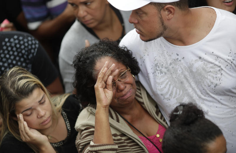 The grandmother of the late 8-year-old Ágatha Sales Felix cries during her granddaughter's burial at the cemetery in Rio de Janeiro, Brazil, Sunday, Sept. 22, 2019. Félix was hit by a stray bullet Friday amid what police said was shootout with suspected criminals. However, residents say there was no shootout, and blame police. (AP Photo/Silvia Izquierdo)