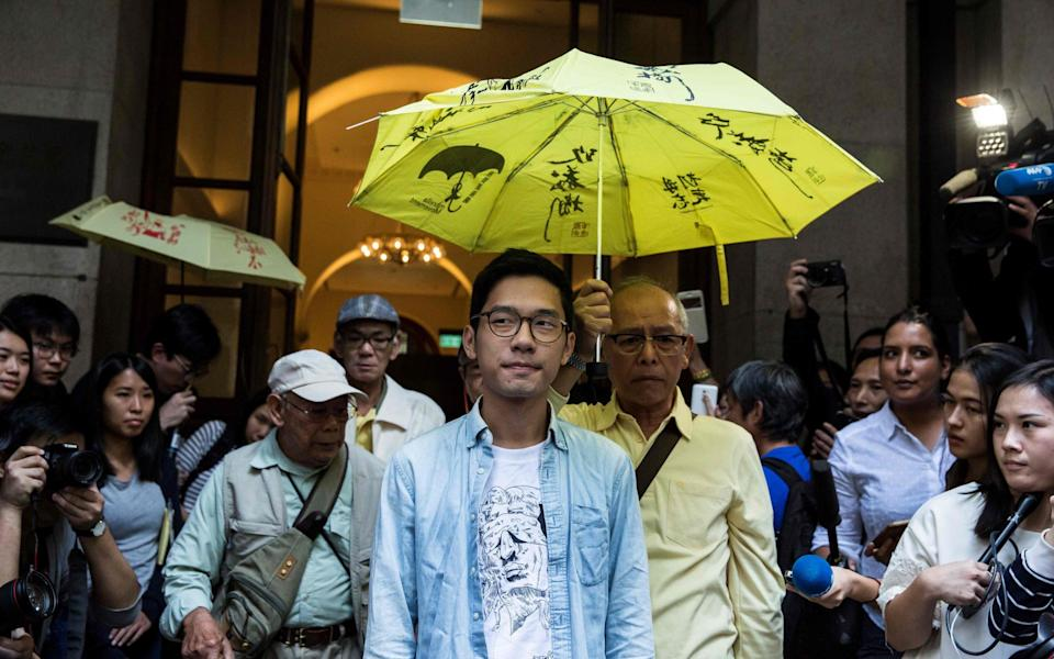 Nathan Law, one of Hong Kong's most prominent young democracy activists, has announced that he has fled to London - Isaac Lawrence/AFP via Getty Images