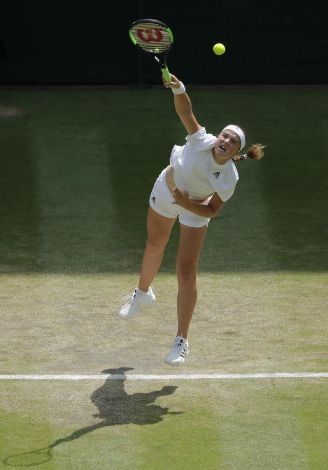 Jelena Ostapenko of Latvia returns a ball to Angelique Kerber of Germany during their women's semifinal match at the Wimbledon Tennis Championships in London, Thursday July 12, 2018. (AP Photo/Ben Curtis, Pool)