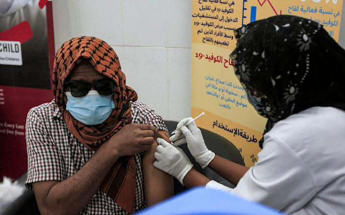 A man receives a dose of the Oxford-AstraZeneca vaccine at the Jabra Hospital in Sudan's capital Khartoum - AFP