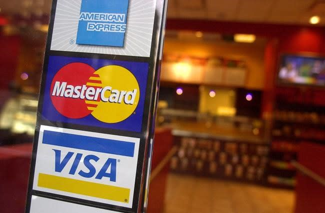 Credit card firms to trim merchant fees, but some retailers 'underwhelmed'