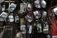 <p>Pakistani pedestrians and vehicles moving on a road are reflected in mirrors displayed for sale outside a mechanic shop, in Rawalpindi, Pakistan, May 23, 2013. (Photo: Muhammed Muheisen/AP) </p>
