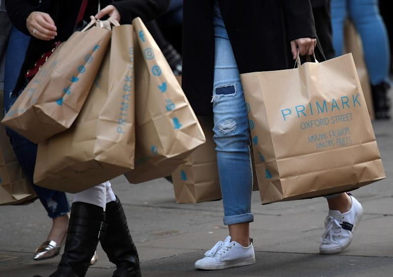 Shoppers carry Primark bags in central London, Britain, November 3, 2017. Picture taken November 3, 2017. REUTERS/Toby Melville