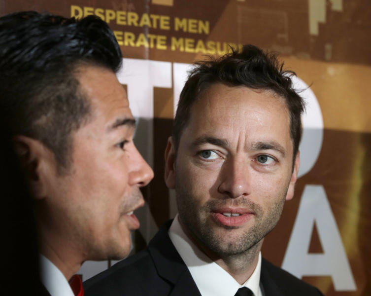 """In this Thursday Oct. 3, 2013 photo, Briton Sean Ellis, right, writer-director of """"Metro Manila"""" - Britain's nominee to the Oscar Awards' best foreign language film, looks at one of his actors Jake Macapagal, as they talk to the media prior to the film's premier screening at a cinema in Taguig city, east of Manila, Philippines. (AP Photo/Bullit Marquez)"""