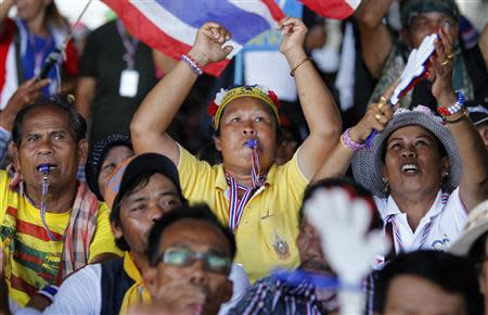 Anti-government protesters blow their whistles during a rally outside the office of Election Commission in Bangkok May 15, 2014. REUTERS/Chaiwat Subprasom