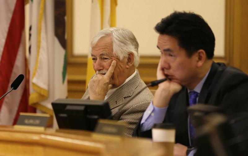 Recreation and Park Commission president Mark Buell, left, and vice president Allen Low, right, listen to public comment during a hearing about a Summer of Love anniversary concert at City Hall Thursday, Feb. 16, 2017, in San Francisco. The show might still go on but a concert planned to mark the 50th anniversary of the Summer of Love has hit another major bureaucratic hurdle. San Francisco's Recreation and Park Commission on Thursday upheld its decision earlier this month to deny a permit for the concert. (AP Photo/Eric Risberg)