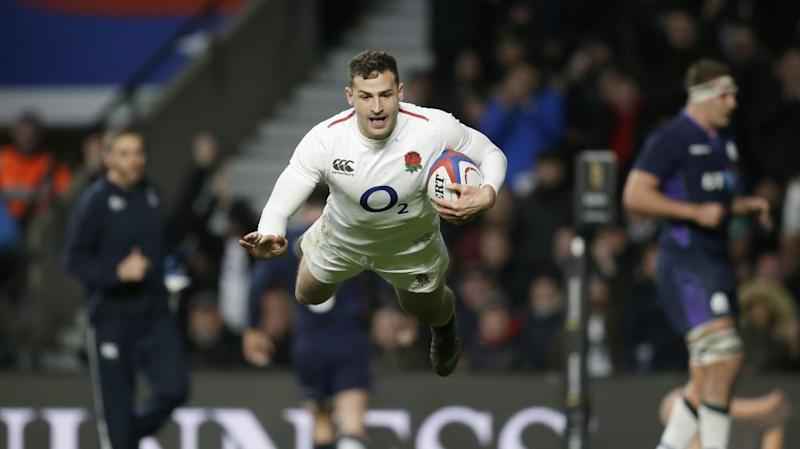 England's Jonny May scoring a try in a recent rugby match