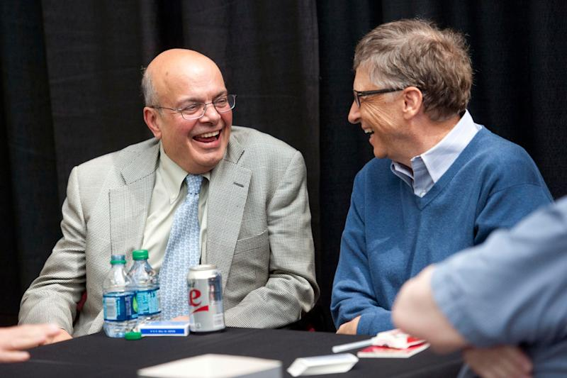 Ajit Jain, head of Berkshire Hathaway reinsurance business, left talks with Bill Gates, chairman and founder of Microsoft Corp. and the director of Berkshire Hathaway Inc. as they play on the sidelines of the Berkshire Hathaway shareholders' meeting in Omaha, Nebraska, USA on Sunday, May 4, 2014. (Daniel Acker (Bloomberg via Getty Images)