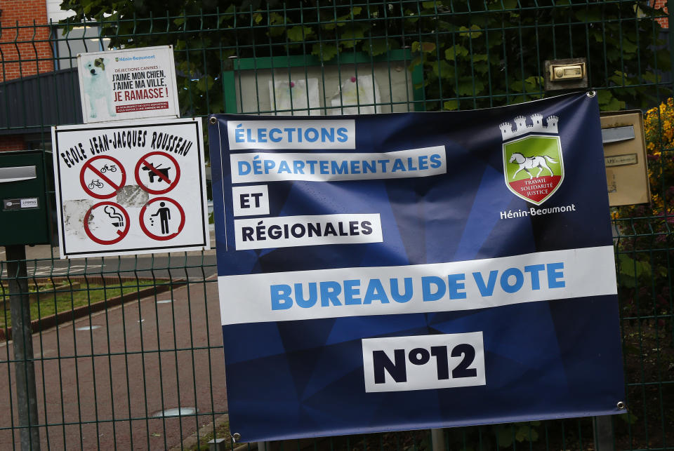 The voting booth for the regional elections in Henin-Beaumont, northern France, Friday, June 25, 2021. Marine Le Pen's far right party is riding high on her tough-on-security, stop-immigration message as French voters start choosing regional leaders Sunday in an election that's seen as a dress rehearsal for next year's presidential vote. (AP Photo/Michel Spingler)