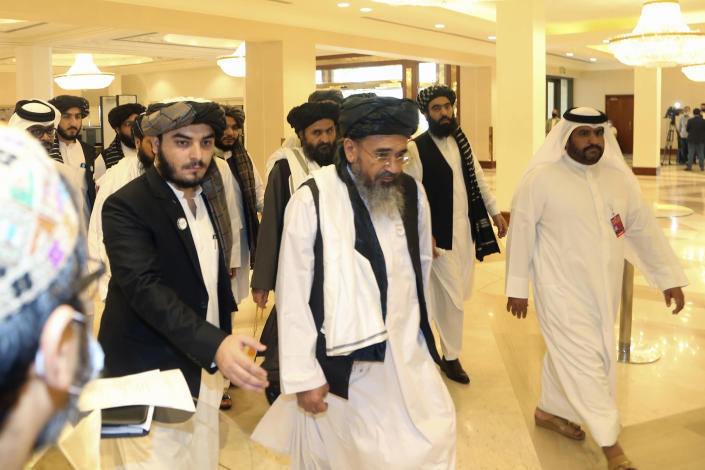 Taliban delegation arrive to attend the opening session of the peace talks between the Afghan government and the Taliban in Doha, Qatar, Saturday, Sept. 12, 2020. (AP Photo/ Hussein Sayed)