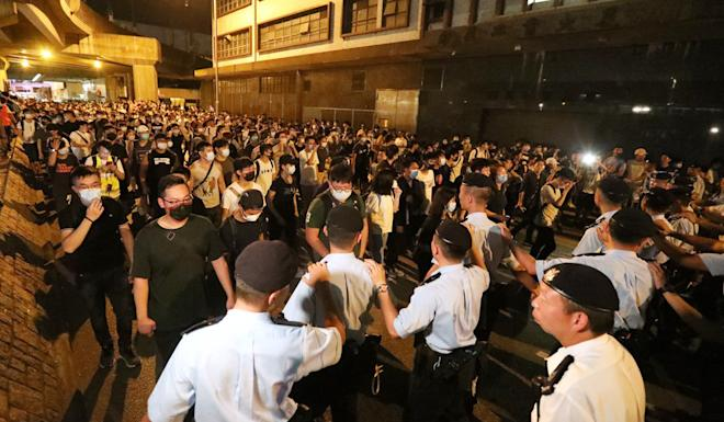 Police officers stop protesters during a march at Tuen Mun on July 6. Photo: Felix Wong