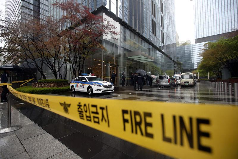 South Korea policemen stand guard at an entrance of a Samsung Group's building in Seoul