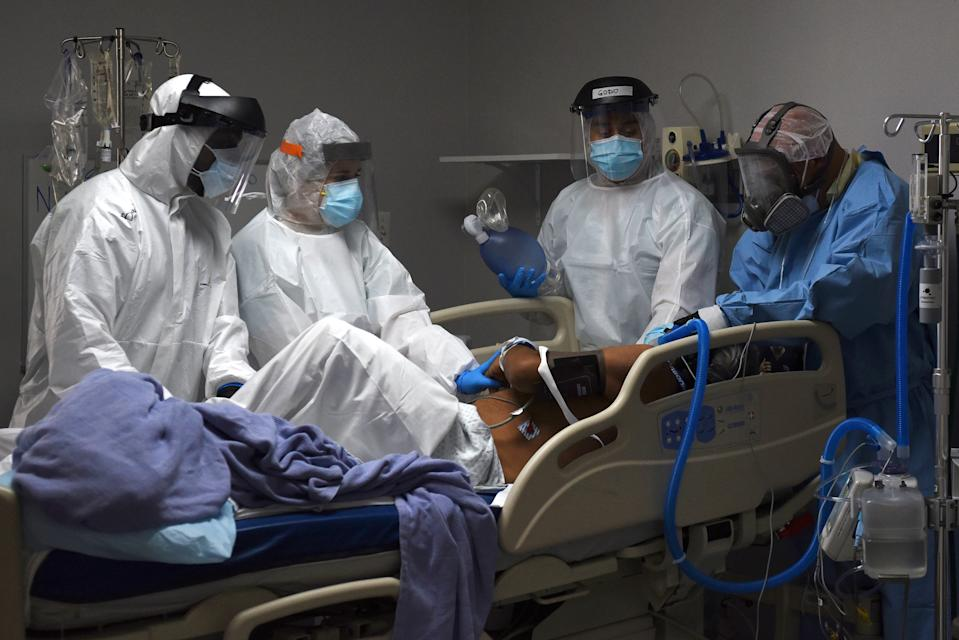 FILE PHOTO: Medical workers prepare to intubate a coronavirus disease (COVID-19) patient at the United Memorial Medical Center's coronavirus disease (COVID-19) intensive care unit in Houston, Texas, U.S., June 29, 2020. REUTERS/Callaghan O'Hare