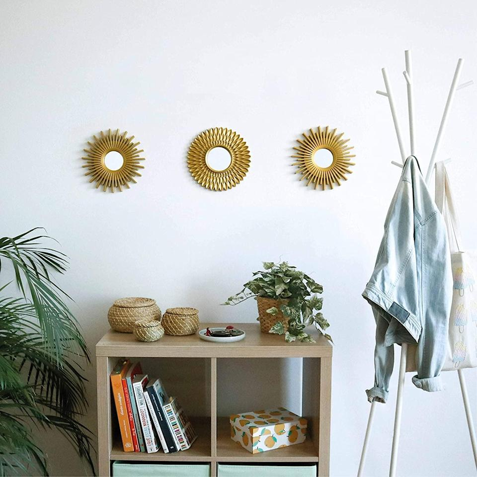 <p>These <span>Bonnyco Gold Mirrors (Pack of 3)</span> ($15) will add functional elegance in the area above your couch.</p>