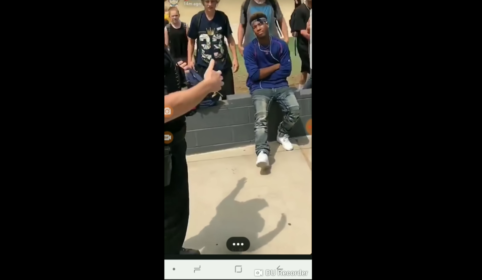A high school student named Valentino says a teacher at Apache Junction High School in Arizona called the police on him for not removing his bandana. (Photo: YouTube/my lil woody)
