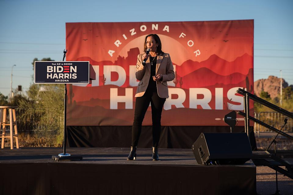 California senator and Democratic vice presidential nominee Kamala Harris speaks during a drive-in campaign rally in Phoenix, Arizona on Wednesday.